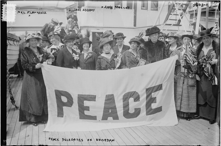 American delegates, including Jane Addams (front row, second from the left), on their way to the International Congress of Women, held at The Hague in 1915. From the Library of Congress.